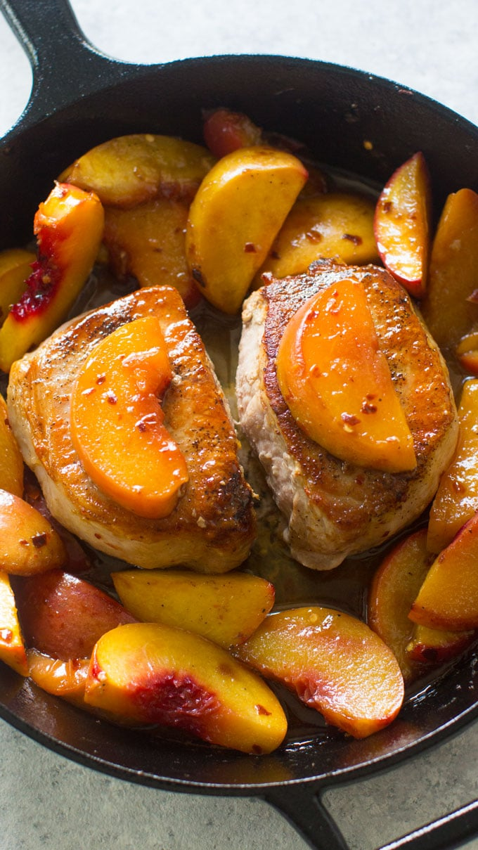 One Pan Peach Pork Chops are the perfect combination of sweet and savory. An easy and beautiful meal, ready in just 30 minutes.