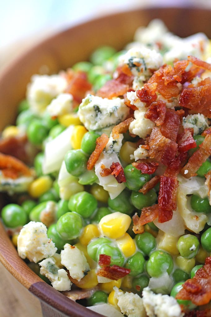 Creamy Ranch Bacon Pea Salad with sweet corn, is the perfect summery side dish. Made with creamy ranch, lots of blue cheese and delicious, crispy bacon.