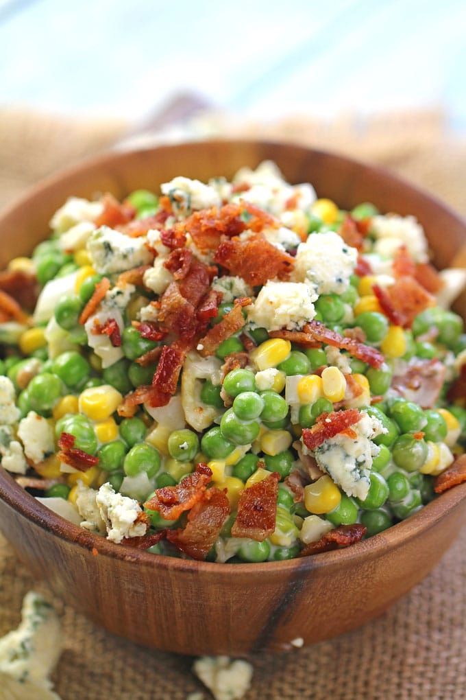 Creamy Ranch Bacon Pea Salad is the perfect summery side dish. Made with creamy ranch, lots of blue cheese and delicious, crispy bacon.