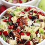 Brussels Sprouts Salad is a quick and easy side dish made with shredded brussels sprouts,crispy apples, cranberries, pomegranate arils, feta cheese, and pecans. #salad #thanksgiving #christmasrecipes #sidedish #30minutemeals