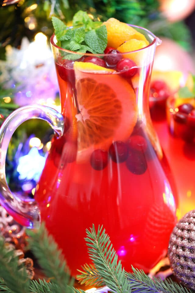 Christmas Punch is made with fresh cranberries, various juices, and sparkling water. #christmaspunch #christmasrecipes #drinks #30minutemeals #holidayrecipes