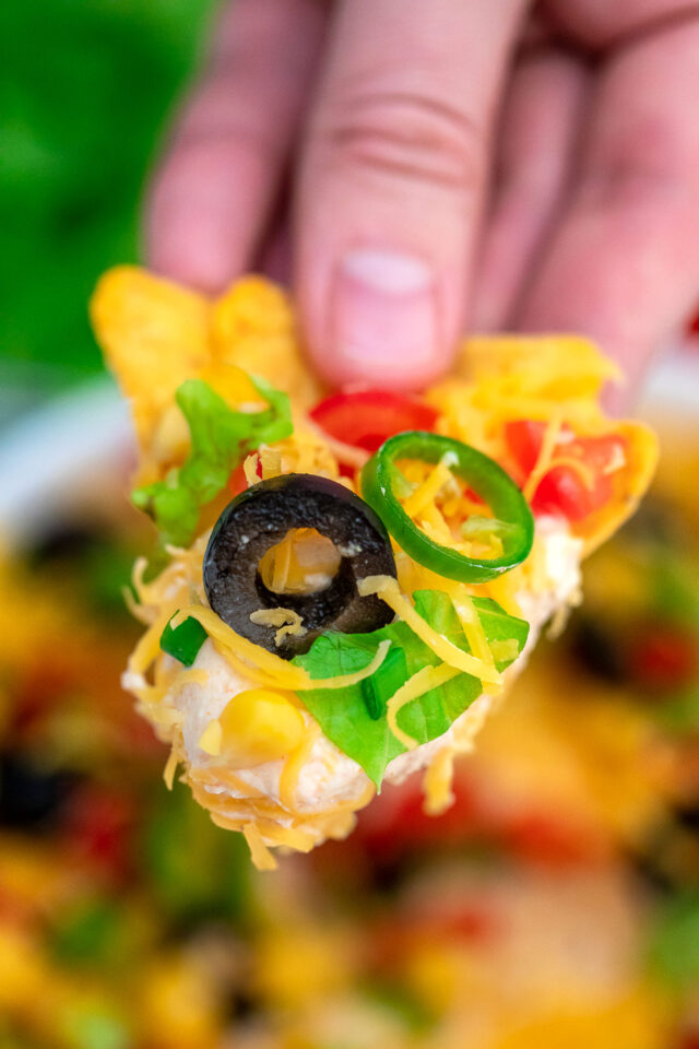 Taco Dip is the perfect snack for game day or party appetizer that is ready in just 5 minutes. #tacodip #appetizers #partyfood #30minutemeals #mexicanrecipes