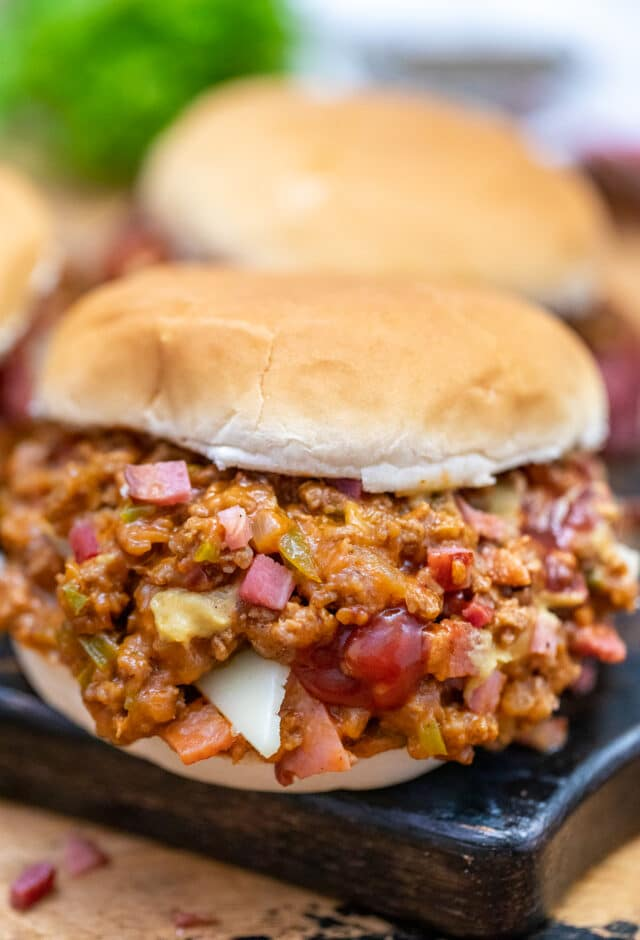 Philly Cheesesteak Sloppy Joes are made with ground beef, tender bell pepper, onions, and gooey melted cheese! #sloppyjoes #beefrecipes #easydinner #30minutemeals #phillycheesesteak