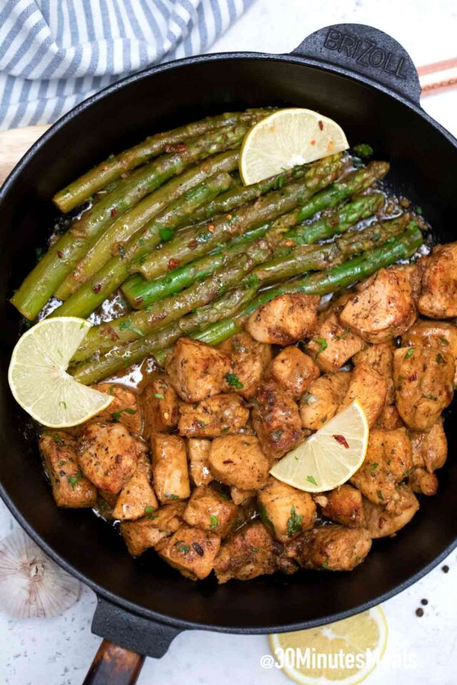chicken with asparagus in a cast iron pan