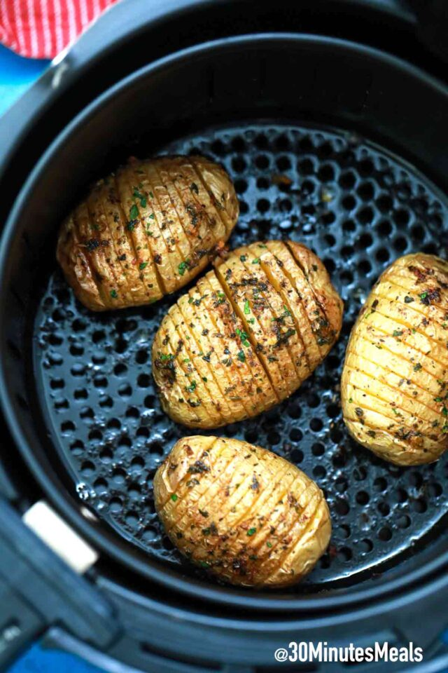 air fried hasselback potatoes in air fryer basket