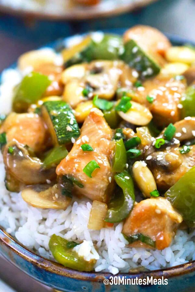 almond chicken on bowls with rice