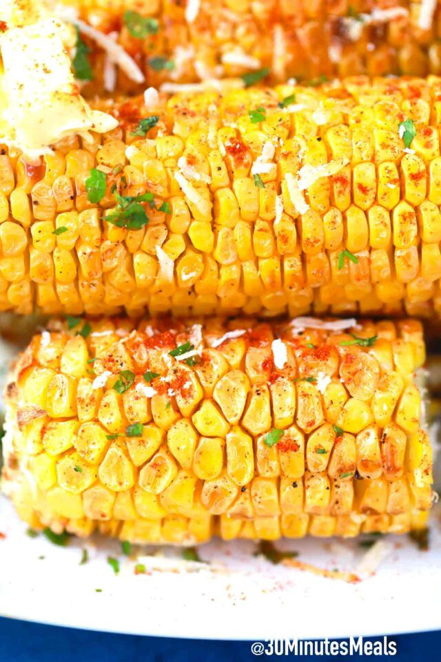 corn ears with butter paprika and parsley