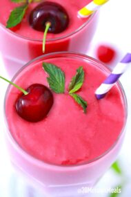 cherry smoothie with a fresh cherry