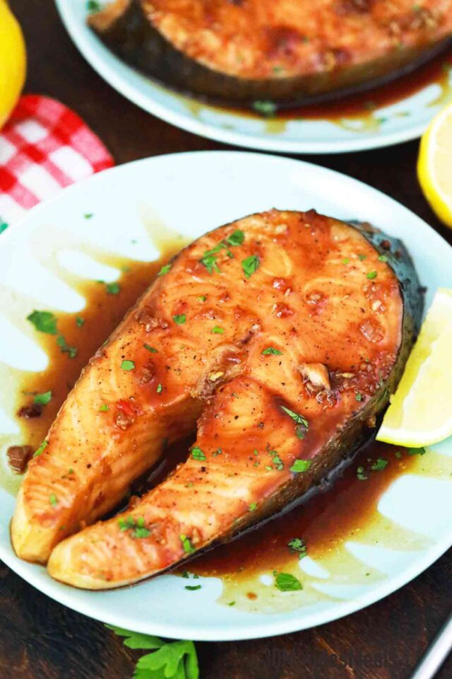 salmon steak with sauce on a plate